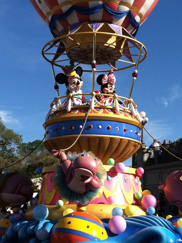 Mickey and Minnie float in Festival of Fantasy Parade